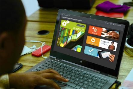 Below grade level student uses Tutorials on his laptop.