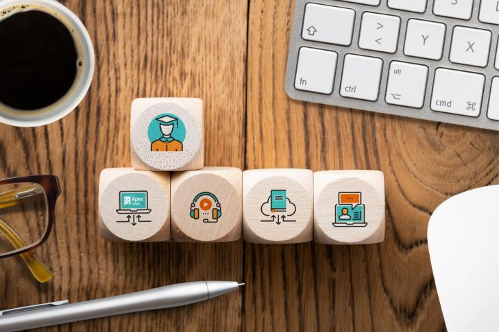 Components of Digital Learning as Icons on Cubes on Wooden Background