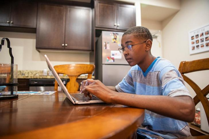 Student learning from a computer at home