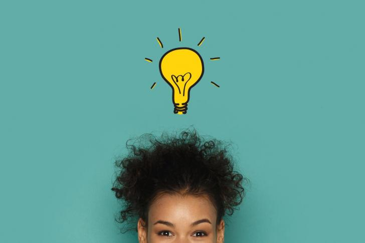 Idea light bulb above woman's head