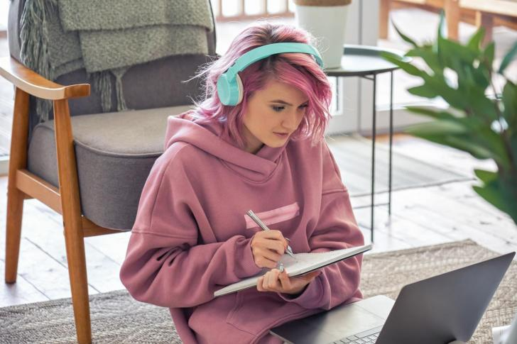 Focused teen girl school student learning online at home